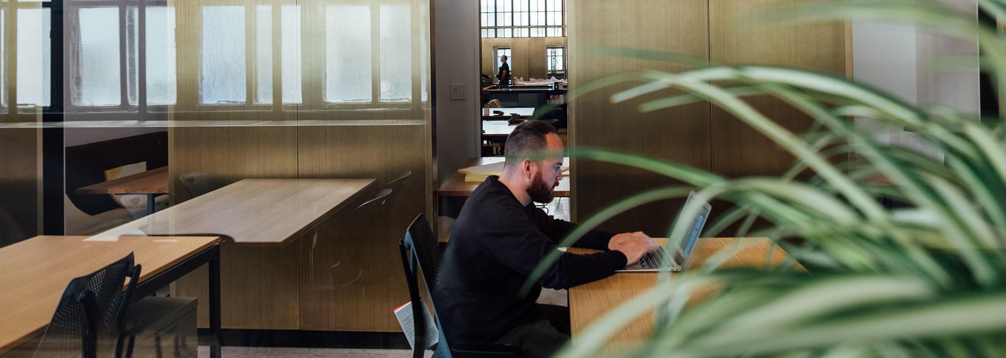 Man sitting at laptop in foyer
