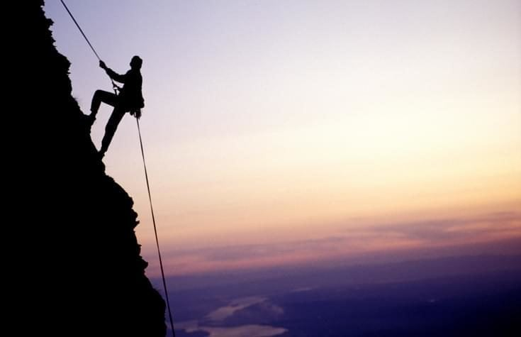 Silhouette of a climber on a mountainside