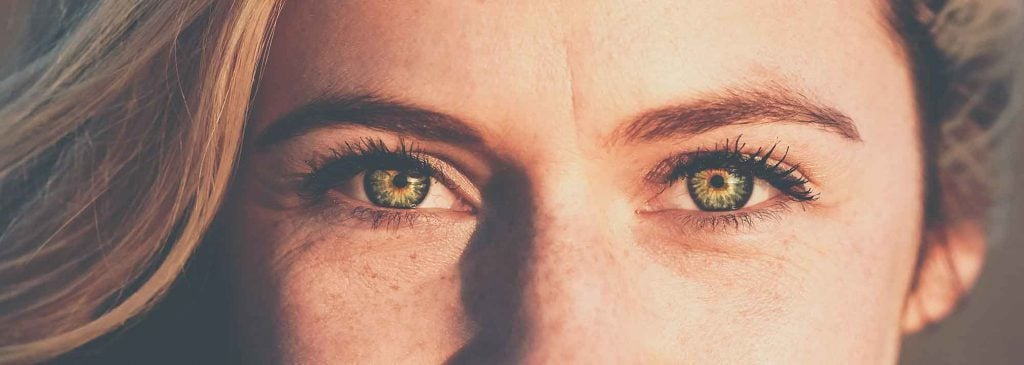 Woman with green eyes staring into camera