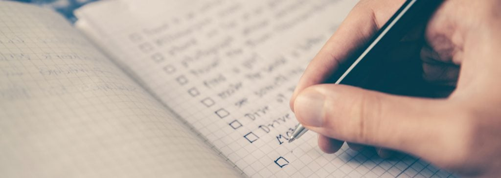 Person writing checklist