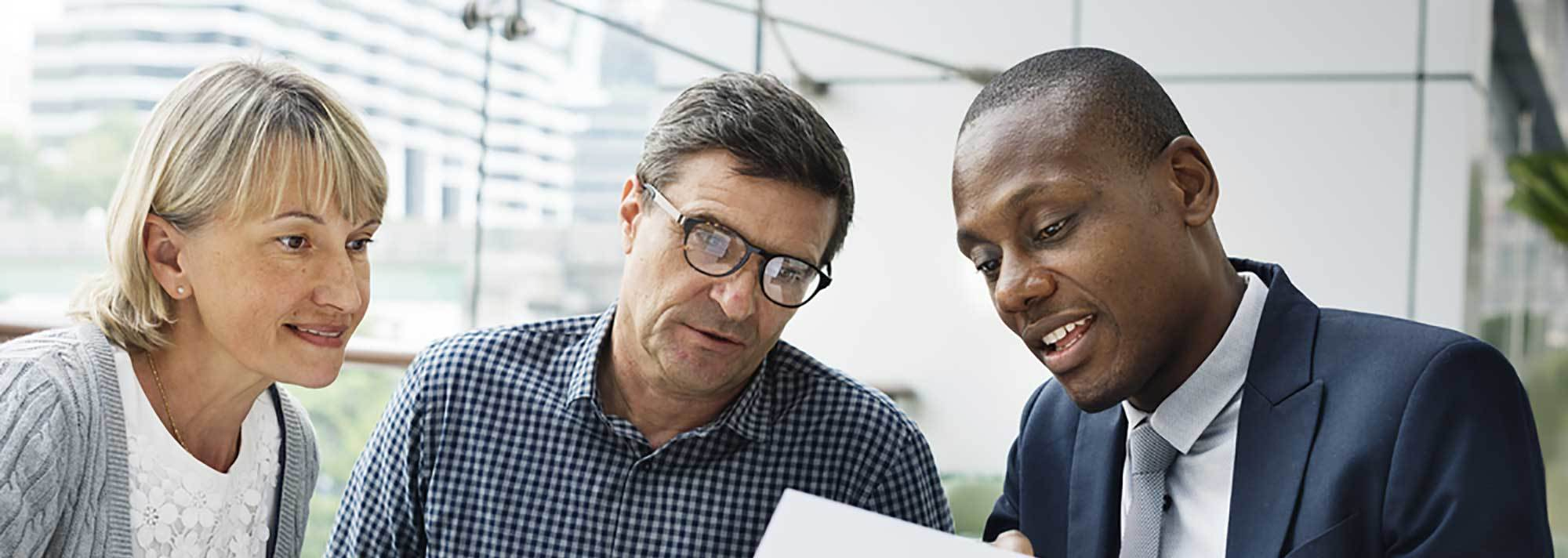 Couple sitting with financial planner discussing whether they should retire