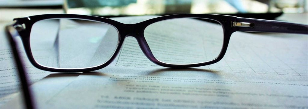 Close up image of spectacles left on top of document